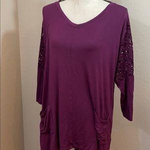 logo by Lori Goldstein large purple blouse
